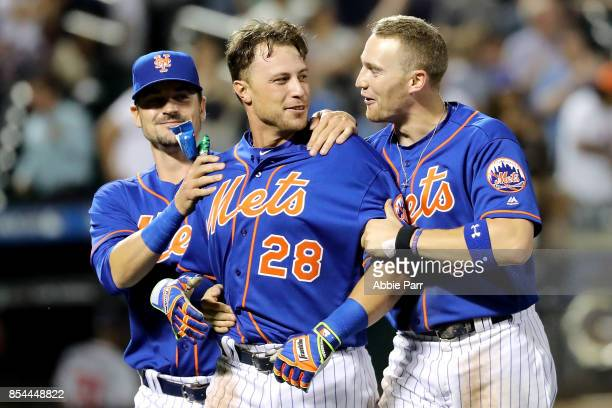 Travis Taijeron of the New York Mets celebrates with teammates after hitting a walk off single in the ninth inning to defeat the Atlanta Braves 43 on...