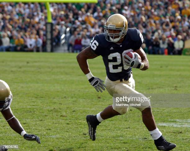 Travis Thomas of the Irish, turns his run upfield and in to the endzone for a touchdown at Notre Dame Stadium in South Bend, Indiana on November 12,...