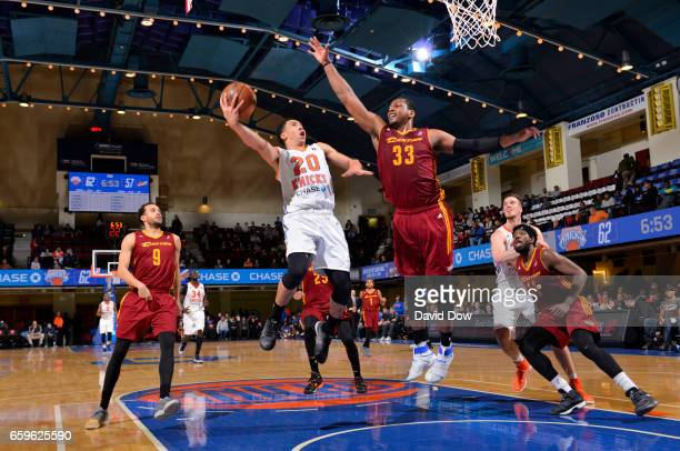 Travis Trice II of the Westchester Knicks shoots against Jonathan Holmes of the Canton Charge at the Westchester County Center on March 28 2017 in...