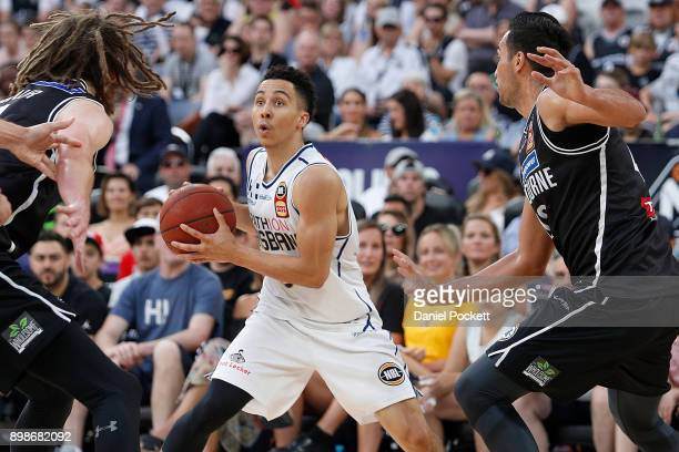 Travis Trice of Brisbane Bullets looks inside during the round 12 NBL match between Melbourne United and the Brisbane Bullets at Hisense Arena on...