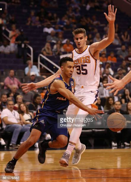 Travis Trice of the Brisbane Bullets drives the ball past Dragan Bender of the Phoenix Suns during the first half of the NBA preseason game at...