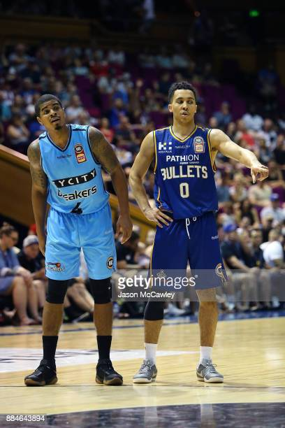 Travis Trice of the Bullets and Edgar Sosa of the Breakers look on during the round eight NBL match between the Brisbane Bullets and the New Zealand...