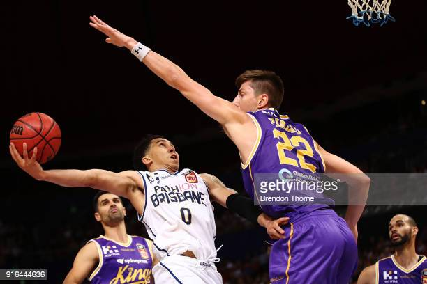 Travis Trice of the Bullets competes with Dane Pineau of the Kings during the round 18 NBL match between the Sydney Kings and the Brisbane Bullets at...