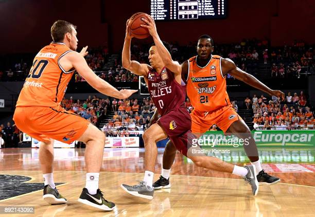 Travis Trice of the Bullets drives to the basket during the round 10 NBL match between the Cairns Taipans and the Brisbane Bullets at Cairns...