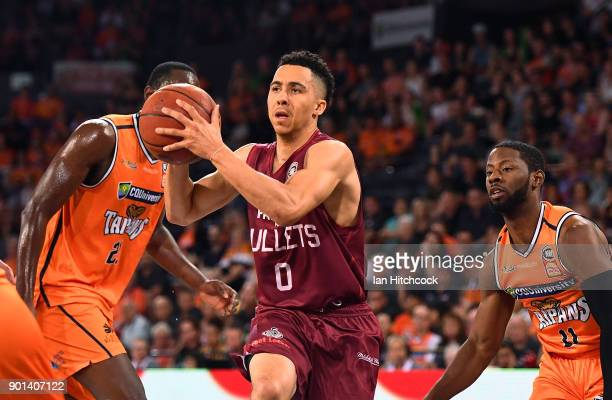 Travis Trice of the Bullets drives to the basket during the round 13 NBL match between the Cairns Taipans and the Brisbane Bullets at the Cairns...