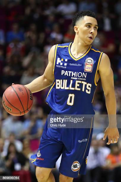 Travis Trice of the Bullets drives to the basket during the round five NBL match between the Brisbane Bullets and the Illawarra Hawks at Brisbane...