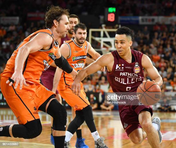 Travis Trice of the Bullets drives to the basket past Alex Loughton of the Taipans during the round 13 NBL match between the Cairns Taipans and the...