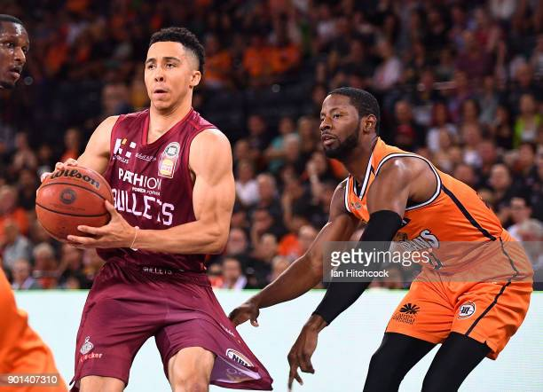 Travis Trice of the Bullets has his pants pulled by Scoochie Smith of the Taipans during the round 13 NBL match between the Cairns Taipans and the...