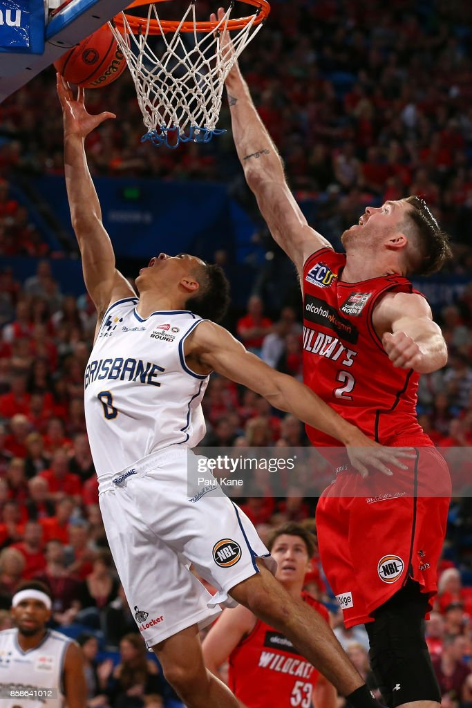 Travis Trice of the Bullets lays up against Lucas Walker of the Wildcats during the round one NBL match between the Perth Wildcats and the Brisbane Bullets at Perth Arena on October 7, 2017 in Perth, Australia.