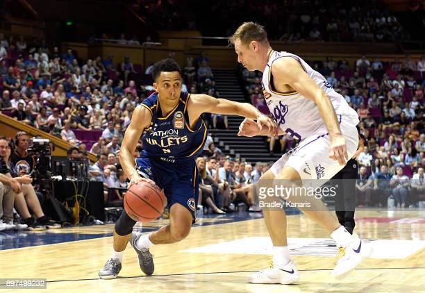Travis Trice of the Bullets takes on the defence of Brad Newley of the Kings during the round 11 NBL match between the Brisbane Bullets and the...