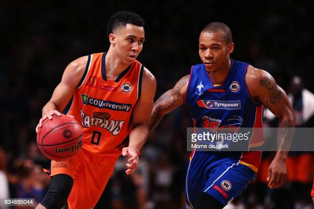 Travis Trice of the Cairns Taipans and Jerome Randle of the Adelaide 36ers compete during the round 19 NBL match between the Adelaide 36ers and the...