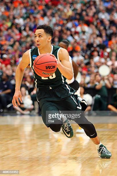Travis Trice of the Michigan State Spartans dribbles against the Louisville Cardinals during the East Regional Final of the 2015 NCAA Men's...