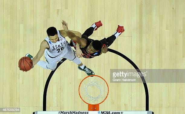 Travis Trice of the Michigan State Spartans drives to the basket against Kenny Gaines of the Georgia Bulldogs during the second round of the 2015...