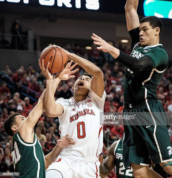 Travis Trice of the Michigan State Spartans fouls Tai Webster of the Nebraska Cornhuskers during their game at Pinnacle Bank Arena January 24 2015 in...