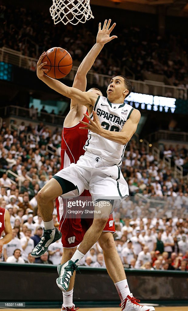 Travis Trice #20 of the Michigan State Spartans gets to the basket in the second half in front of Jared Berggren #40 of the Wisconsin Badgers at the Jack T. Breslin Student Events Center on March 7, 2013 in East Lansing, Michigan. Michigan State won the game 58-43.