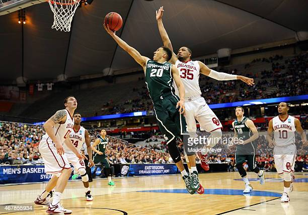 Travis Trice of the Michigan State Spartans shoots the ball in the second half of the game against TaShawn Thomas of the Oklahoma Sooners during the...