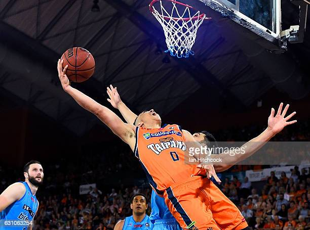 Travis Trice of the Taipans attempts a lay up over Shea Lli of the Breakers during the round 14 NBL match between the Cairns Taipans and the New...