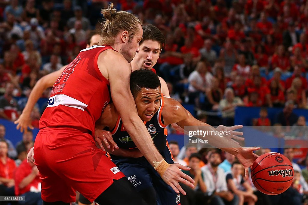 Travis Trice of the Taipans drives to the basket against Jesse Wagstaff of the Wildcatsduring the round 16 NBL match between the Perth Wildcats and the Cairns Taipans at Perth Arena on January 20, 2017 in Perth, Australia.