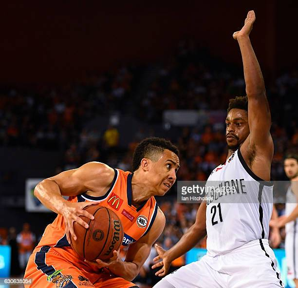 Travis Trice of the Taipans drives to the basket past Casper Ware of Melbourne United during the round 13 NBL match between Cairns and Melbourne on...