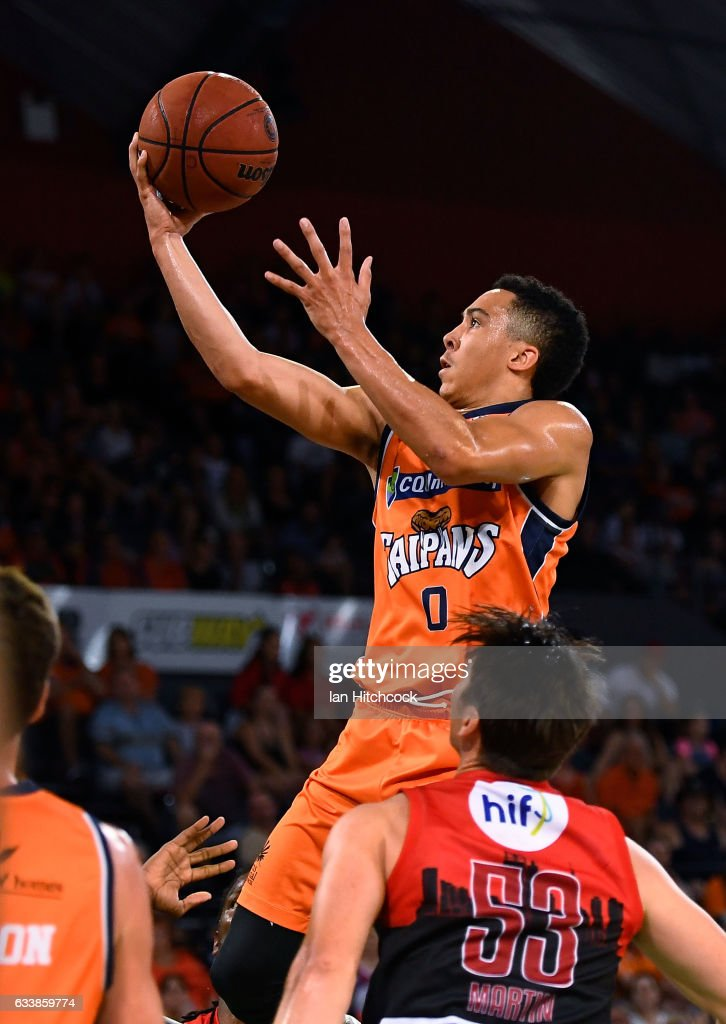 Travis Trice of the Taipans takes a jump shot over Damian Martin of the Wildcats during the round 18 NBL match between the Cairns Taipans and the Perth Wildcats at the Cairns Convention Centre on February 5, 2017 in Cairns, Australia.