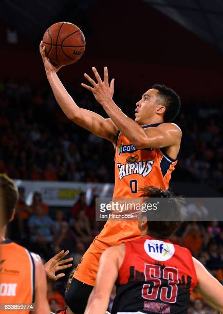 Travis Trice of the Taipans takes a jump shot over Damian Martin of the Wildcats during the round 18 NBL match between the Cairns Taipans and the...