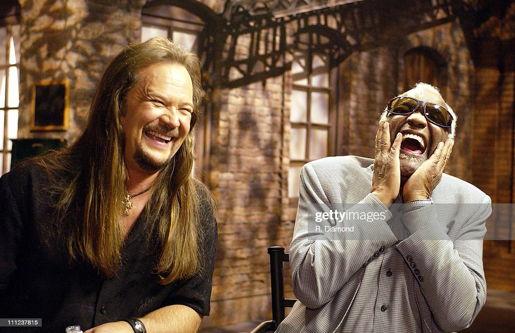 Travis Tritt and Ray Charles during Ray Charles and Travis Tritt Perform on CMT's Crossroads at Grand Old Opry House in Nashville, Tennessee, United States.