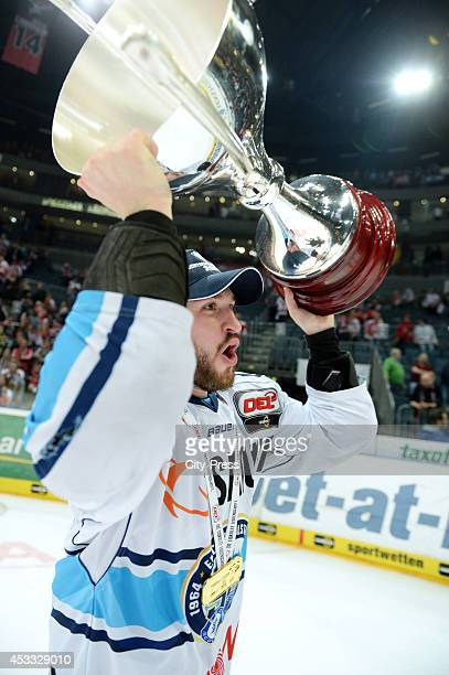 Travis Turnbull holds the trophy after game seven of the DEL playoff final on April 29, 2014 in Cologne, Germany.