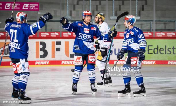 Travis Turnbull Jamie MacQueen and Darin Olver of the Schwenninger Wild Wings celebrate after scoring the 10 during the Magenta Sports Cup match...