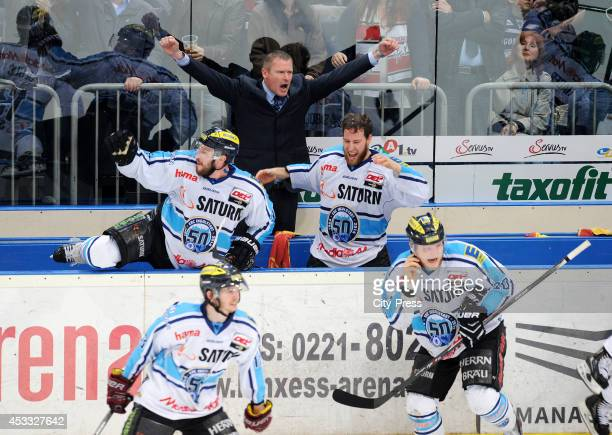 Travis Turnbull Niklas Sundblad Robert Sabolic celebrate the championship after game seven of the DEL playoff final on April 29 2014 in Cologne...