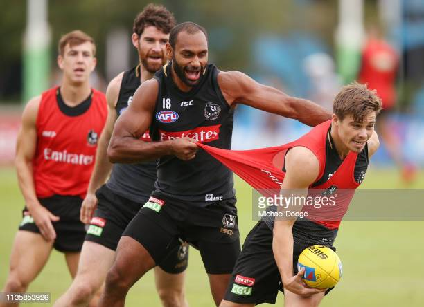 Travis Varcoe of the Magpies tackles Josh Thomas of the Magpies during the Collingwood Magpies Training Session on March 15, 2019 in Melbourne,...