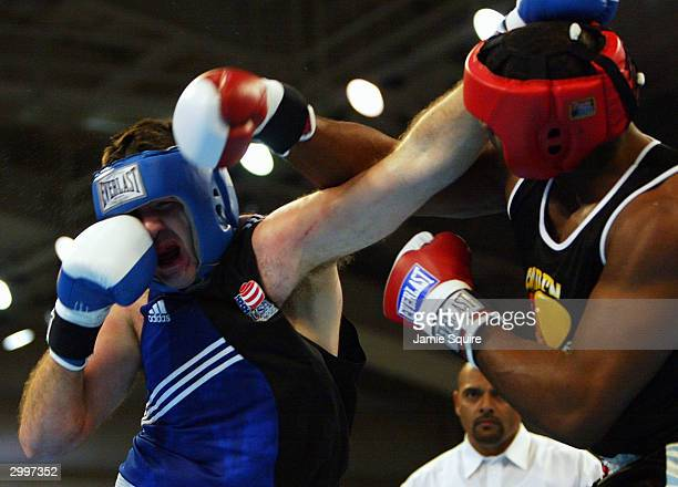 Travis Walker lands a punch against of Nicolai Firtha during their bout in the United States Olympic Team Boxing Trials on February 19 2004 at Tunica...