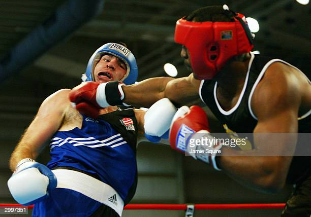 Travis Walker lands a punch on the chin of Nicolai Firtha during their bout in the United States Olympic Team Boxing Trials on February 19 2004 at...