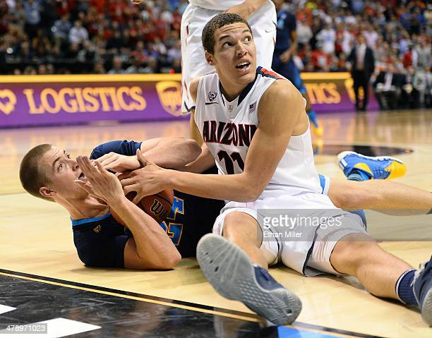 Travis Wear of the UCLA Bruins calls a timeout as he fights Aaron Gordon of the Arizona Wildcats for a loose ball following a Bruins steal late in...