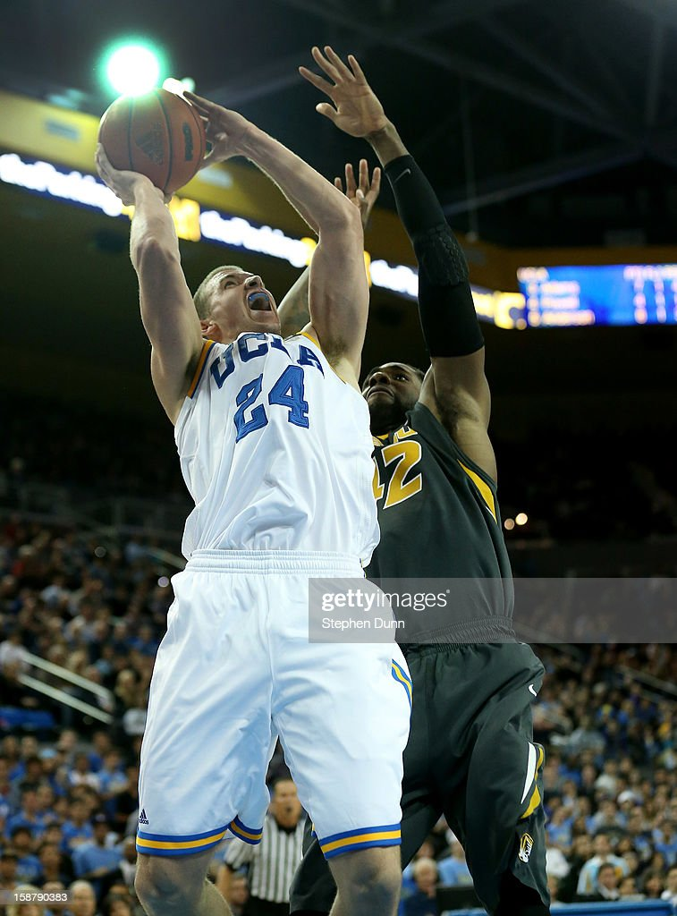 Travis Wear #24 of the UCLA Bruins shoots over Alex Oriakhi #24 of the Missouri Tigers at Pauley Pavilion on December 28, 2012 in Los Angeles, California. UCLA won 97-94 in overtime.