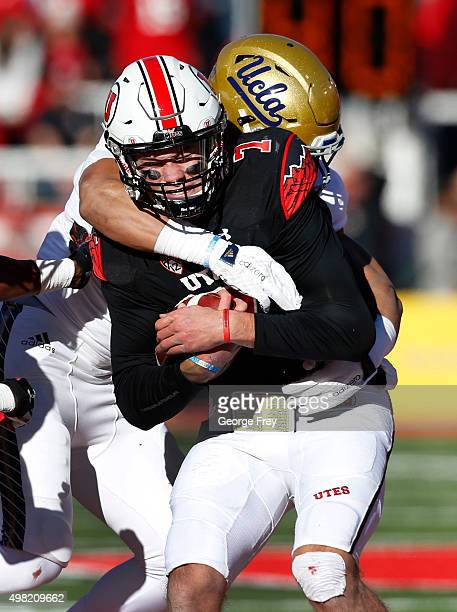 Travis Wilson of the Utah Utes is sacked by Aaron Wallace of the UCLA Bruins during the first half of a college football game at Rice Eccles Stadium...