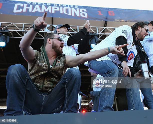 Travis Wood and John Lackey of the Chicago Cubs yell to their families during the Chicago Cubs victory celebration in Grant Park on November 4 2016...