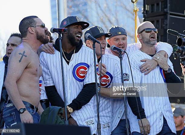 Travis Wood Dexter Fowler Anthony Rizzo Jon Lester and David Ross of the Chicago Cubs sing 'Go Cubs Go' during the Chicago Cubs victory celebration...