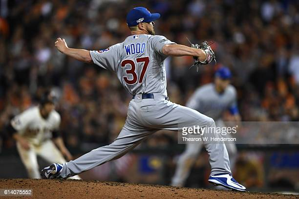Travis Wood of the Chicago Cubs throws a pitch against the San Francisco Giants during Game Four of their National League Division Series at ATT Park...