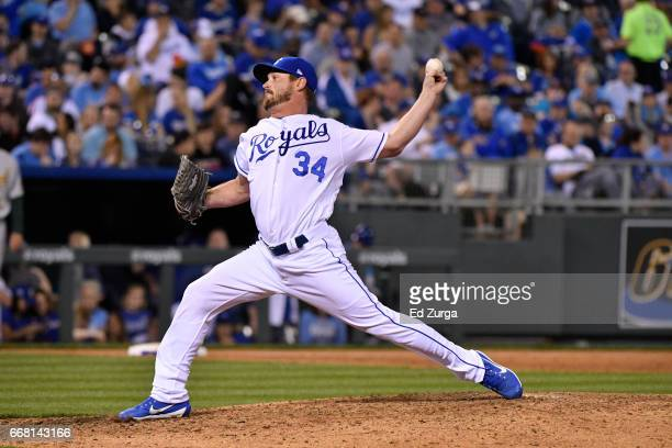 Travis Wood of the Kansas City Royals throws against the Oakland Athletics at Kauffman Stadium on April 12 2017 in Kansas City Missouri