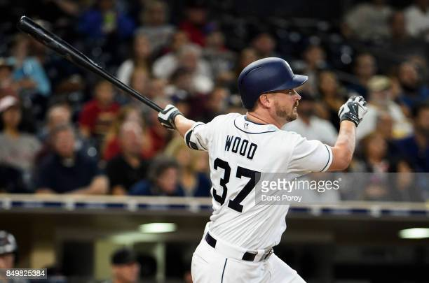Travis Wood of the San Diego Padres hits a two RBI single during the third inning of a baseball game against the Arizona Diamondbacks at PETCO Park...