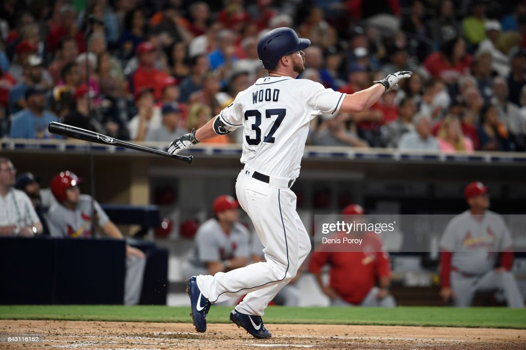 Travis Wood #37 of the San Diego Padres hits a two-run home run during the second inning of a baseball game against the St. Louis Cardinals at PETCO Park on September 5, 2017 in San Diego, California.