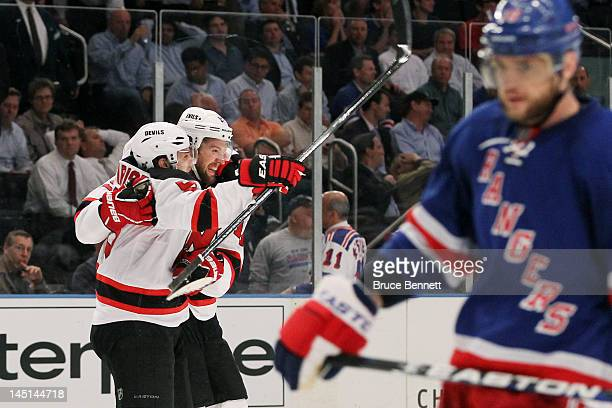 Travis Zajac and Zach Parise of the New Jersey Devils celebrate their 5 to 3 win over the New York Rangers in Game Five of the Eastern Conference...