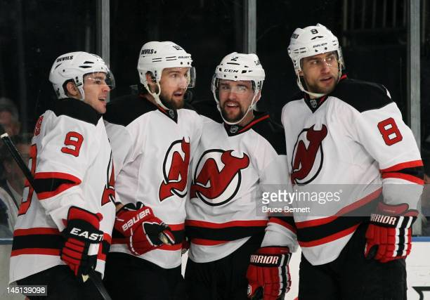 Travis Zajac celebrates his first period goal with Zach Parise Marek Zidlicky and Dainius Zubrus of the New Jersey Devils in Game Five of the Eastern...