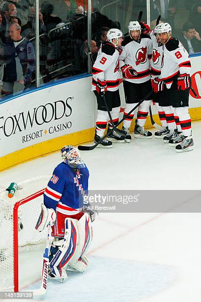Travis Zajac celebrates his first period goal with Zach Parise Marek Zidlicky and Dainius Zubrus of the New Jersey Devils as Henrik Lundqvist of the...