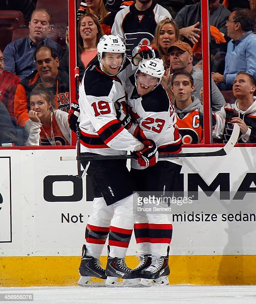 Travis Zajac congratulates Mike Cammalleri of his second period goal against the Philadelphia Flyers at the Wells Fargo Center on October 9 2014 in...
