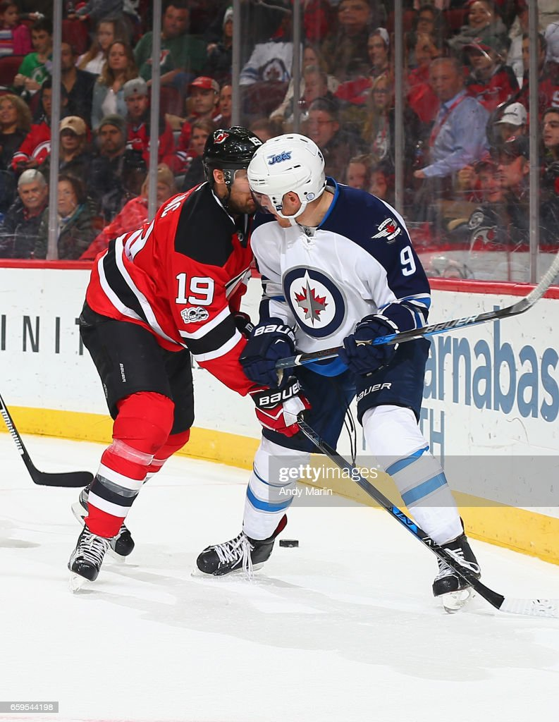big sale 8f1ea 56a1b Travis Zajac of the New Jersey Devils and Andrew Copp of the ...