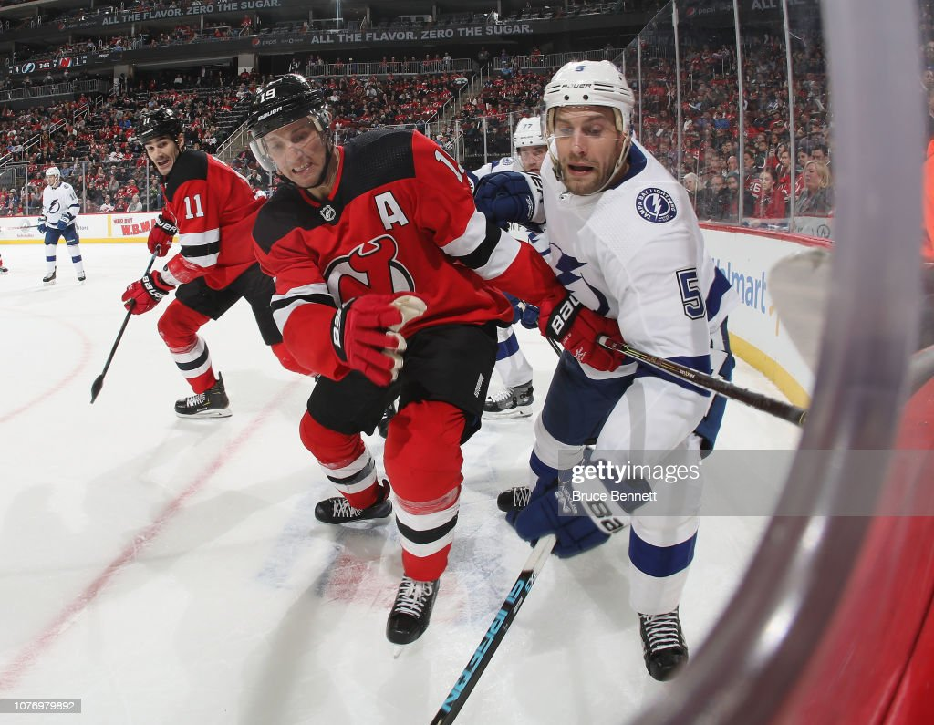 low priced e9f43 ca069 Travis Zajac of the New Jersey Devils and Dan Girardi of the ...