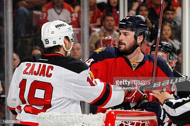 Travis Zajac of the New Jersey Devils and Erik Gudbranson of the Florida Panthers tangle behind the net in Game Five of the Eastern Conference...