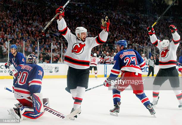 Travis Zajac of the New Jersey Devils celebrates a goal by teammate David Clarkson of the New Jersey Devils as Henrik Lundqvist of the New York...