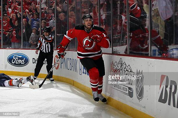 Travis Zajac of the New Jersey Devils celebrates after he scored the game-winning goal in overtime against the Florida Panthers in Game Six of the...